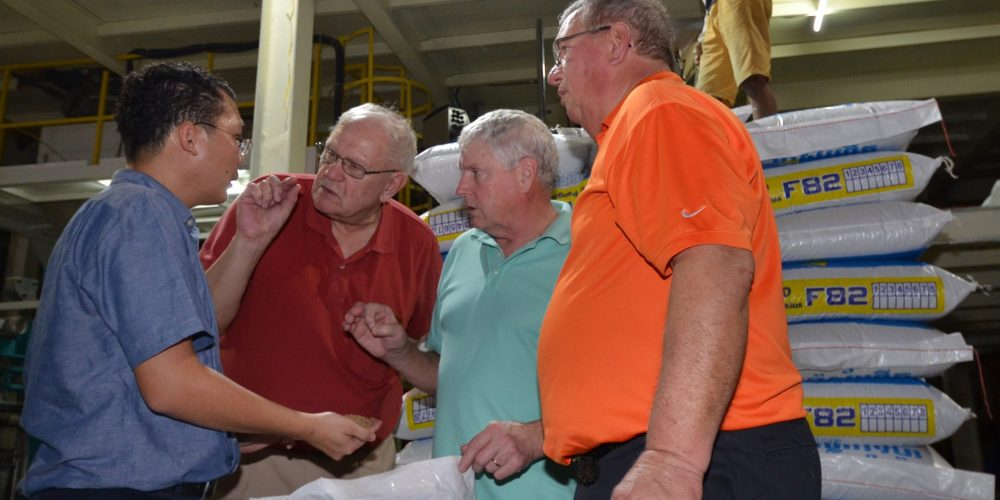 Rady Chea, general manager of the first feed mill in Cambodia to add a manufacturing line for fish feed, discusses soy protein with USB Director & WISHH Ex-Officio Member David Williams of Michigan, ASA Director and WISHH Program Committee Member Morey Hill of Iowa, and WISHH Program Committee Member and Past Missouri Soybean Merchandising Council Chair David Lueck.